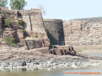 Powerfull looking Gagron Fort Battlments with the river below, India.