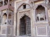 Nicely carved Jahangir Mahal Gate with it's elephants - Orchha, India